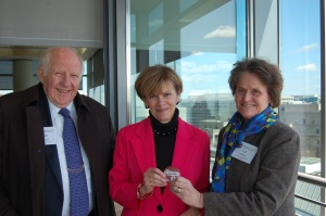Liz Parker and Allen Beerman present Jan Neuharth with a NNA pin